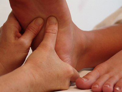 reflexology Reflexology massage massaging foot feet pressure points promote health
